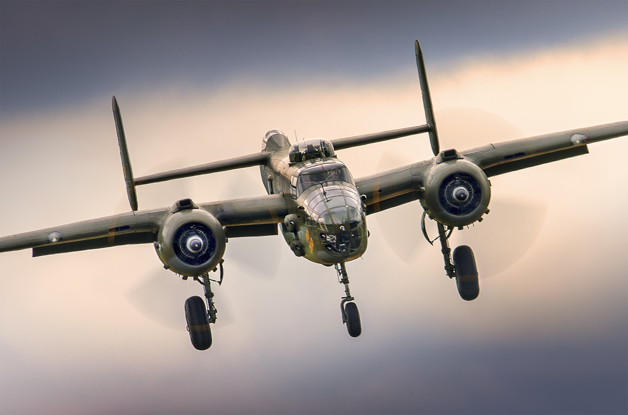 IMAGE: http://markfingar.com/photogallery/Aircraft/MAM_WOTB_2016/B25_break_in_The_weather.jpg